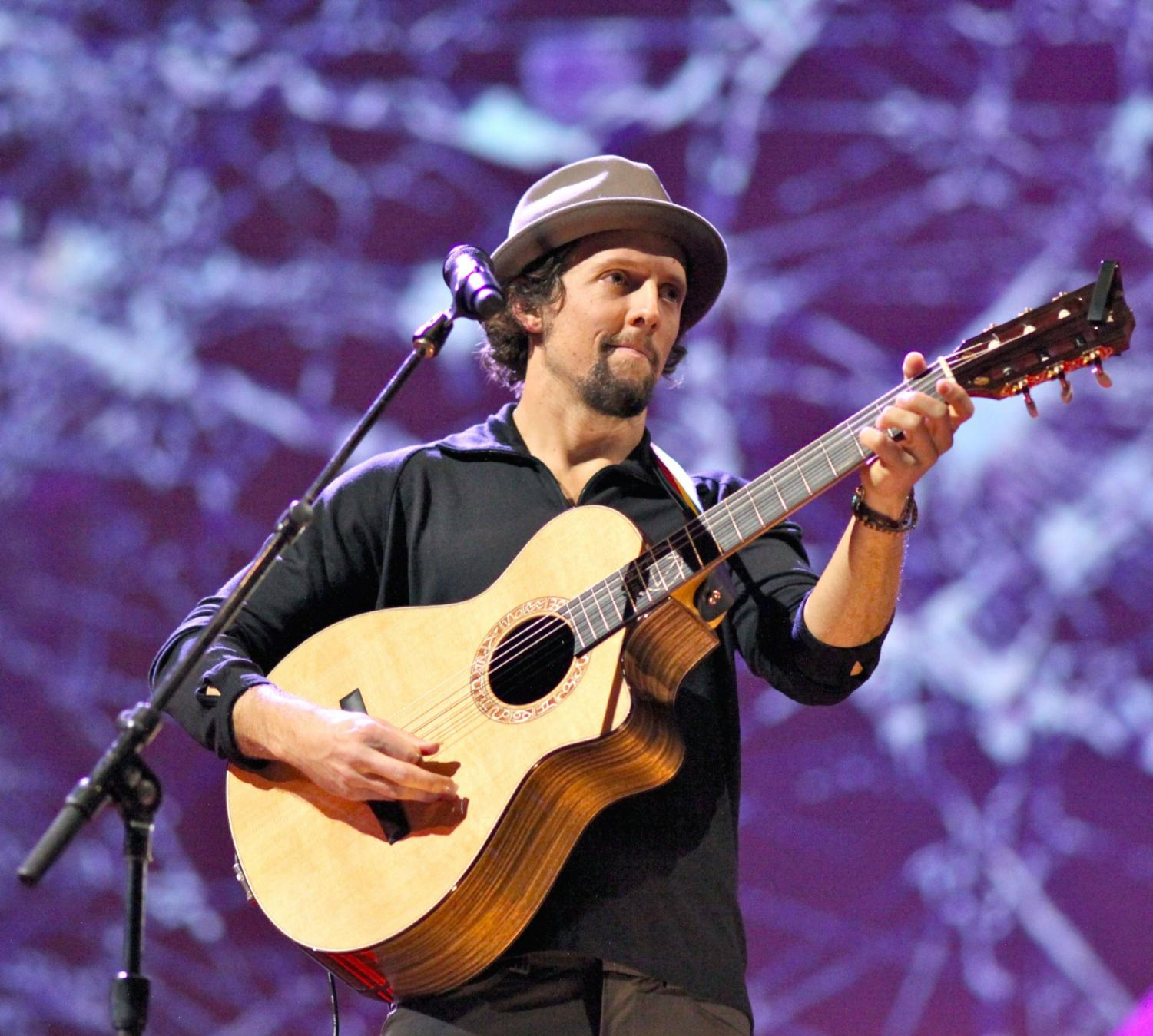 Jason Mraz performs on an acoustic guitar in March 2011.