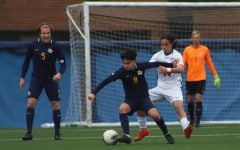 DePaul's Jacob Seeto defending a Marquette forward during a 1-0 loss at Wish Field on Tuesday afternoon.