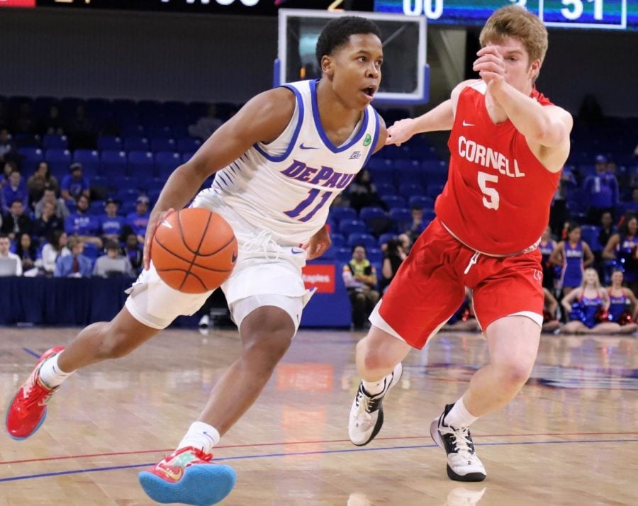 DePaul+junior+guard+Charlie+Moore+drives+to+the+basket+in+the+second+half+against+Cornell+at+Wintrust+Arena