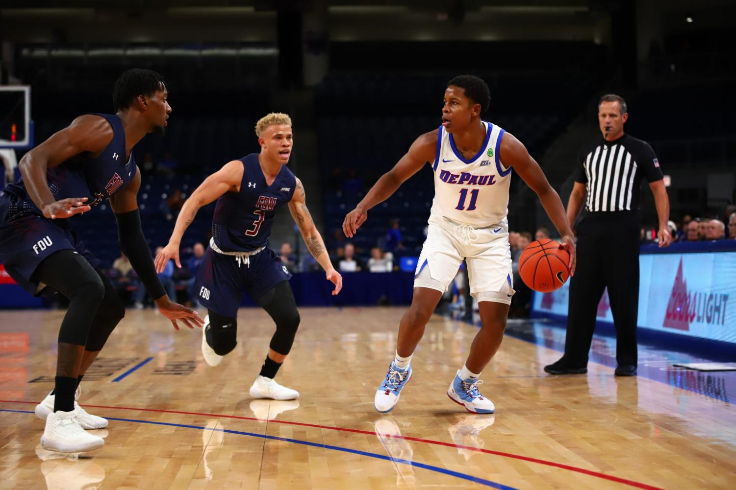 DePaul junior guard Charlie Moore dribbles the ball against Fairleigh Dickinson on Friday at Wiintrust Arena. The Blue Demons won the game 70-59.