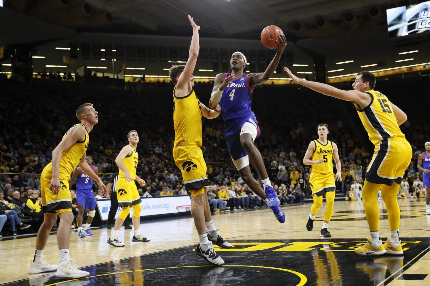 DePaul junior forward Paul Reet drives to the basket in the first half against Iowa at the Carver-Hawkeye Arena. The Blue Demons won the game 93-78.
