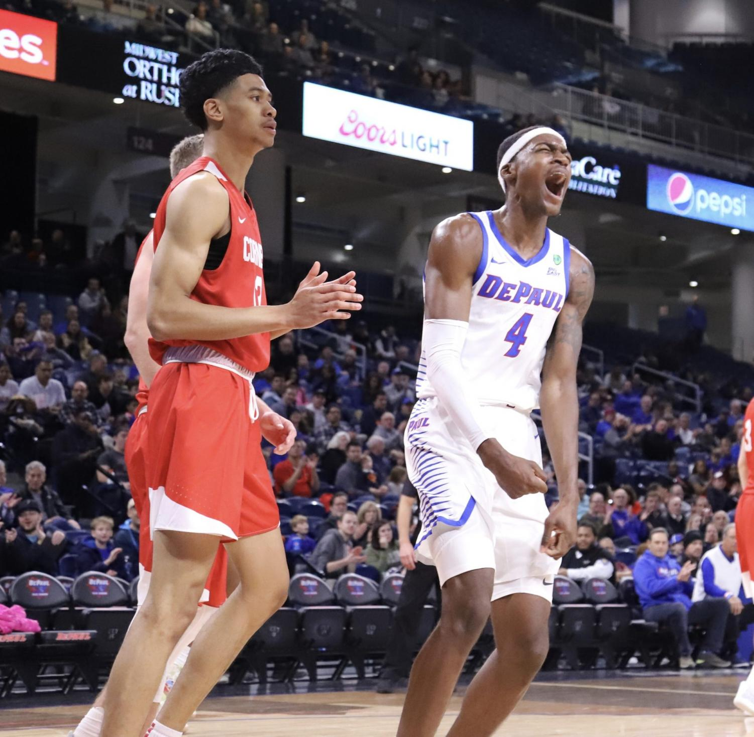 DePaul junior forward Paul Reed celebrates after a play in the second half against Cornell on Nov. 16 at Wintrust Arena.