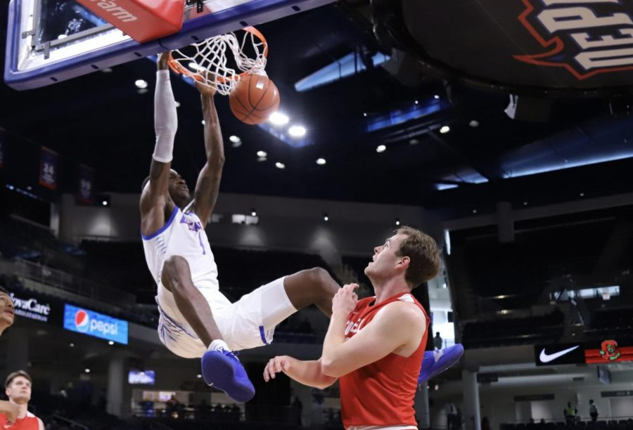 DePaul freshman forward Romeo Weems dunks the ball against Cornell on Saturday at Wintrust Arena.