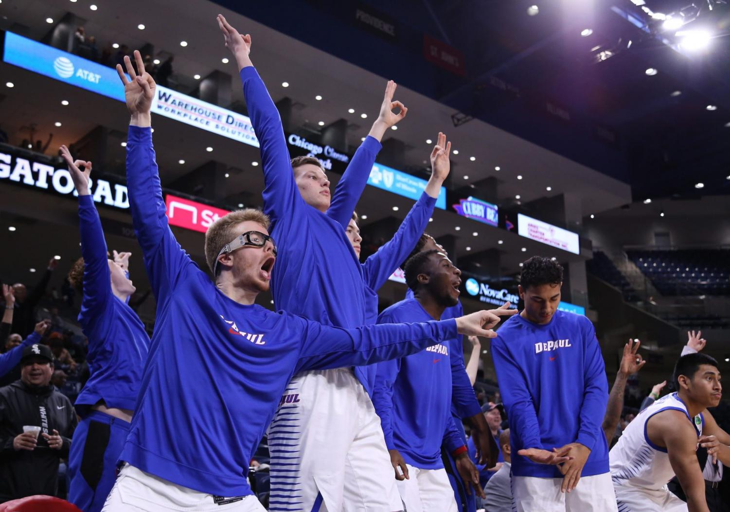 The DePaul bench celebrates during the second half against Central Michigan on Tuesday at Wintrust Arena. The Blue Demons won the game 88-75.