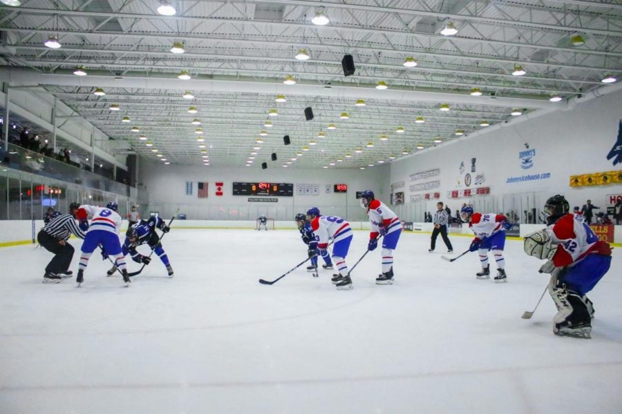 Players from DePaul and Marian line up for a faceoff during the first period on Friday, Nov. 22.
