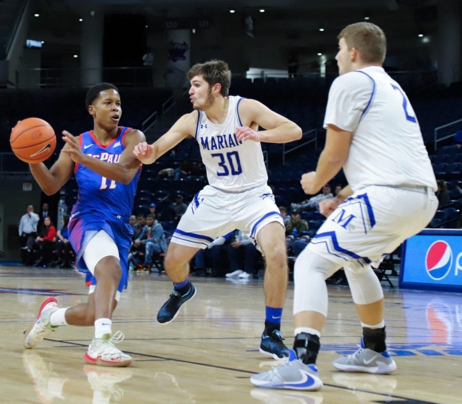 DePaul+junior+guard+Charlie+Moore+goes+for+a+bounce+pass+against+Marian+on+Oct.+29+at+Wintrust+Arena.+