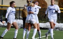 The DePaul women's soccer team celebrates after scoring a goal against Marquette on Friday at Wish Field.