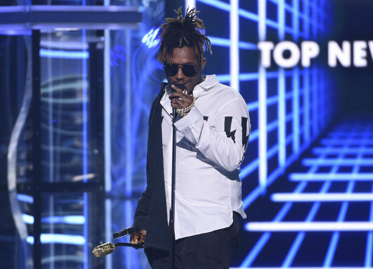 In this May 1, 2019 file photo, Juice WRLD accepts the award for top new artist at the Billboard Music Awards at the MGM Grand Garden Arena in Las Vegas. The Chicago-area rapper, whose real name is Jarad A. Higgins, was pronounced dead Sunday, Dec. 8 after a
