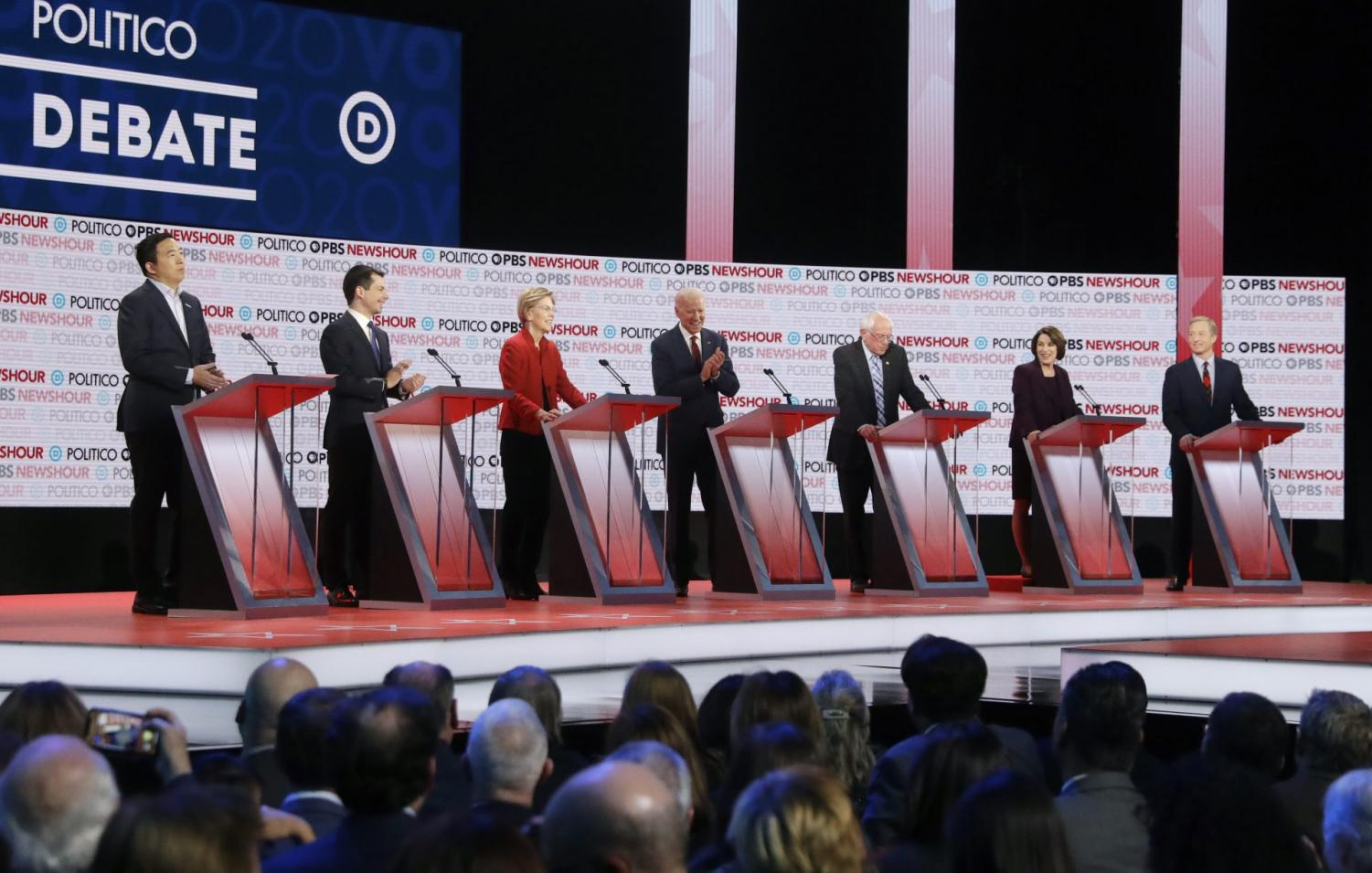 Democratic presidential candidates from left, entrepreneur Andrew Yang, South Bend Mayor Pete Buttigieg, Sen. Elizabeth Warren, D-Mass., former Vice President Joe Biden, Sen. Bernie Sanders, I-Vt., Sen. Amy Klobuchar, D-Minn., and businessman Tom Steyer participate in a Democratic presidential primary debate Thursday, Dec. 19, 2019, in Los Angeles.