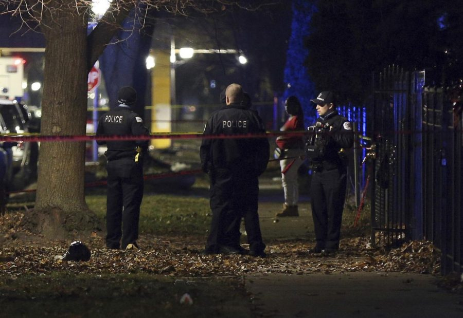 Chicago+police+guard+a+crime+scene+in+the+5700+block+of+S.+May+Street+in+Chicago+after+several+people+were+shot+there+on+Sunday%2C+Dec.+22%2C+2019.