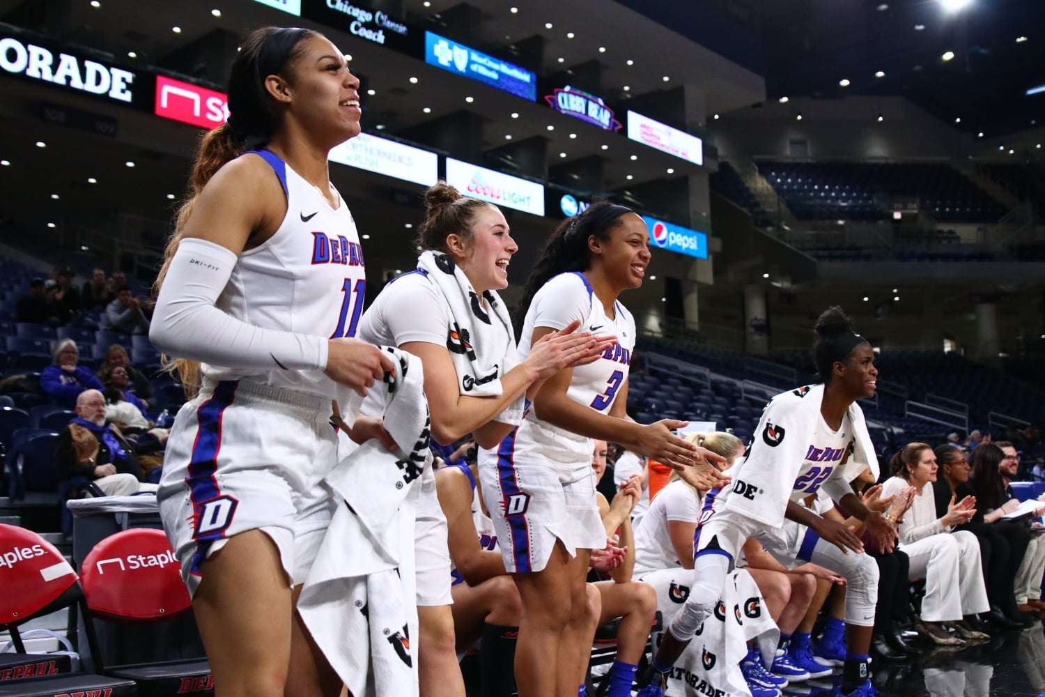 The DePaul bench celebrates during the second half against Alabama State.