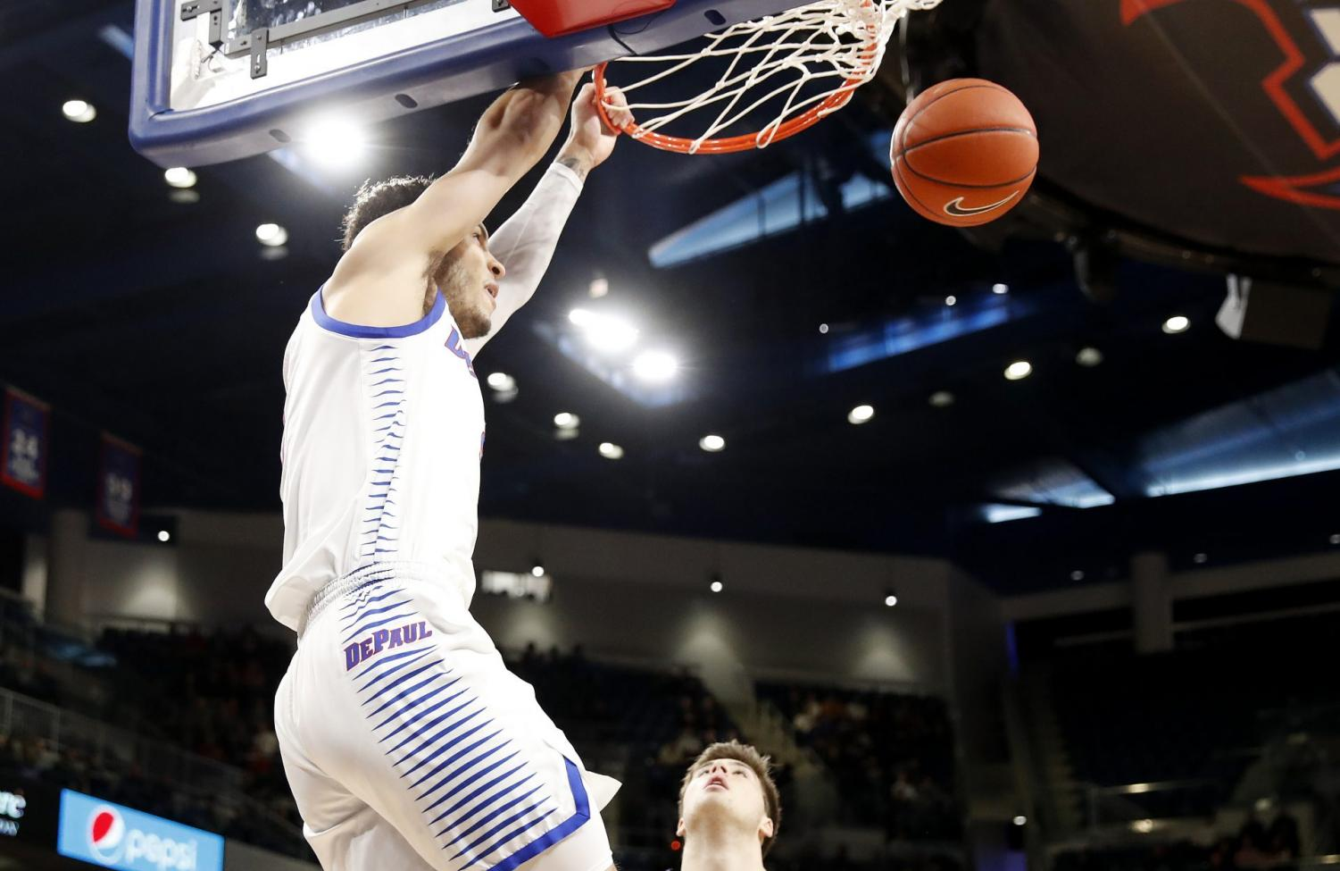 DePaul junior forward Jaylen Butz dunks the ball against Northwestern. Butz finished the game with 24 points.