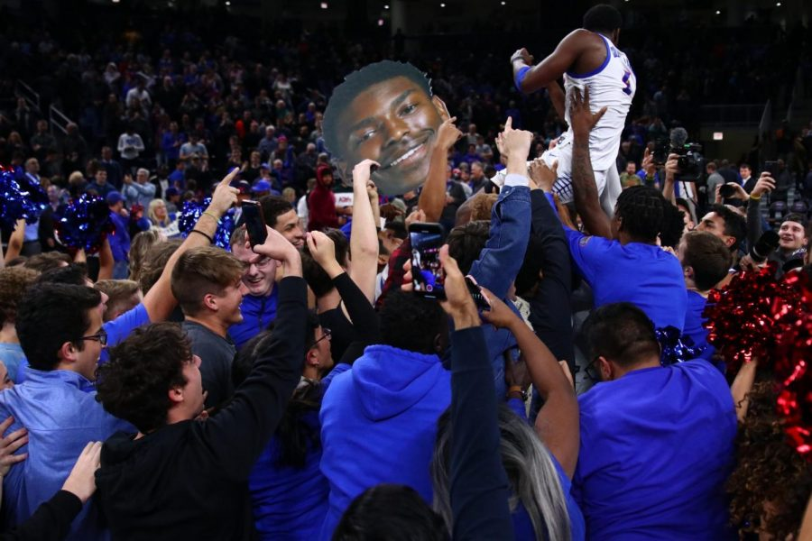 DePaul senior guard Jalen Coleman-Lands gets hoisted into the air by fans after DePaul defeated Texas Tech 65-60 in overtime.