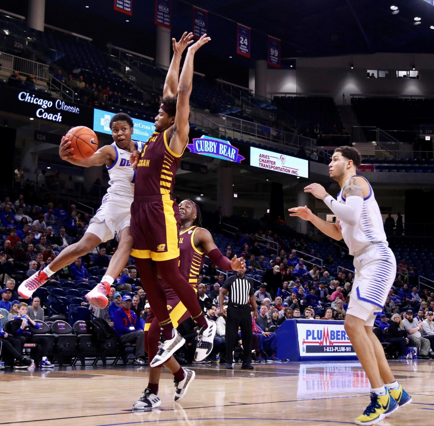 DePaul junior guard Charlie Moore goes for a pass to fellow junior Jaylen Butz against Central Michigan on Nov. 26 at Wintrust Arena.