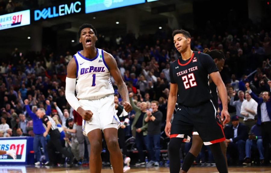 DePaul+freshman+Romeo+Weems+celebrates+after+a+dunk+in+overtime.+The+Blue+Demons+won+the+game+65-60+against+Texas+Tech.+