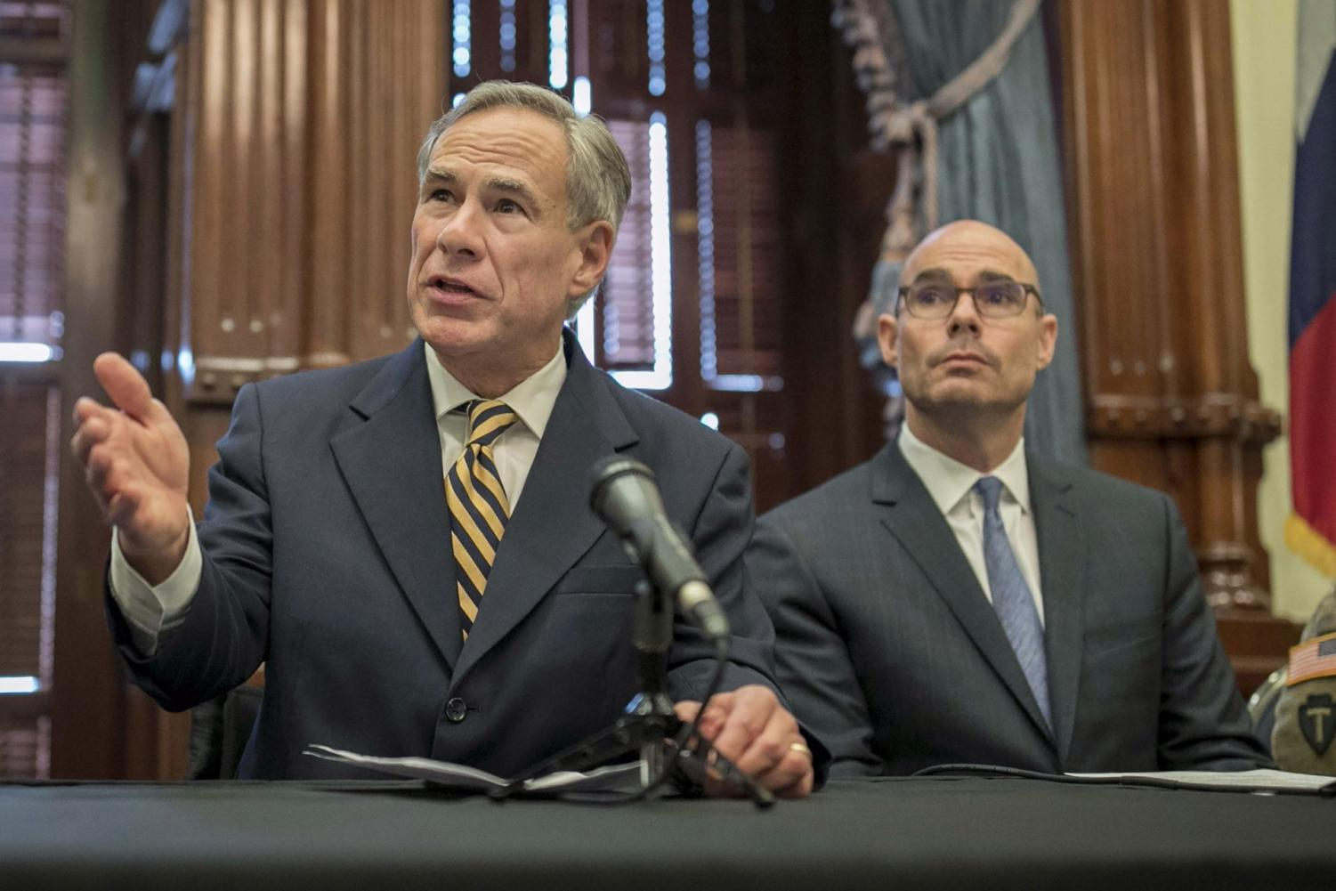 In this June 21, 2019 file photo, Gov. Greg Abbott, left, speaks at a news conference at the Capitol, in Austin, Texas. Abbott says the state will reject the re-settlement of new refugees, becoming the first state known to do so under a recent Trump administration order.