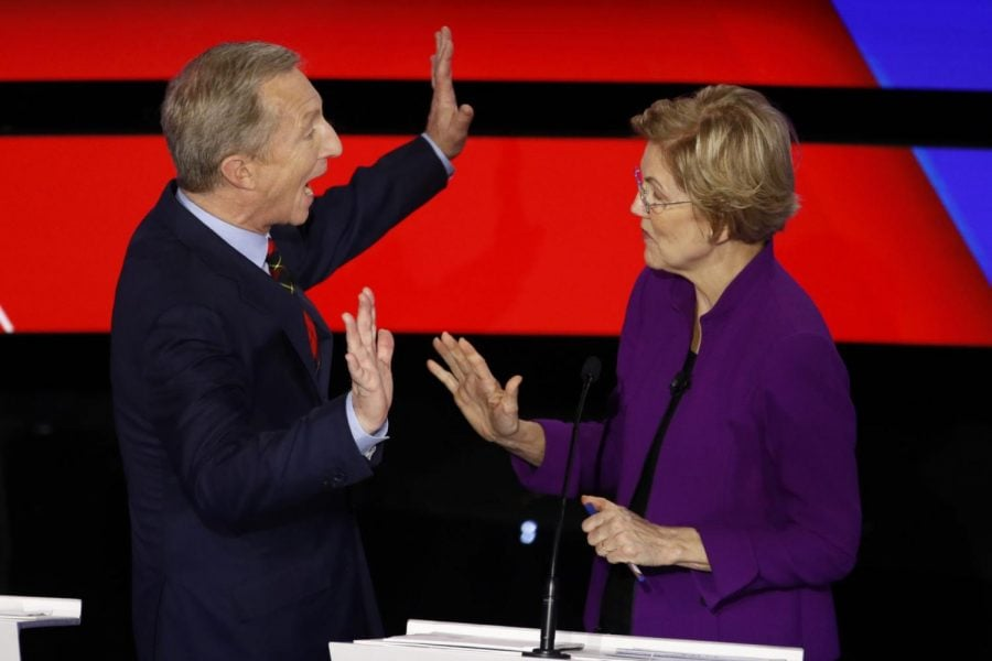 Democratic presidential candidates businessman Tom Steyer, left and Sen. Elizabeth Warren, D-Mass., talk during a break Tuesday, Jan. 14, 2020, during a Democratic presidential primary debate hosted by CNN and the Des Moines Register in Des Moines, Iowa.