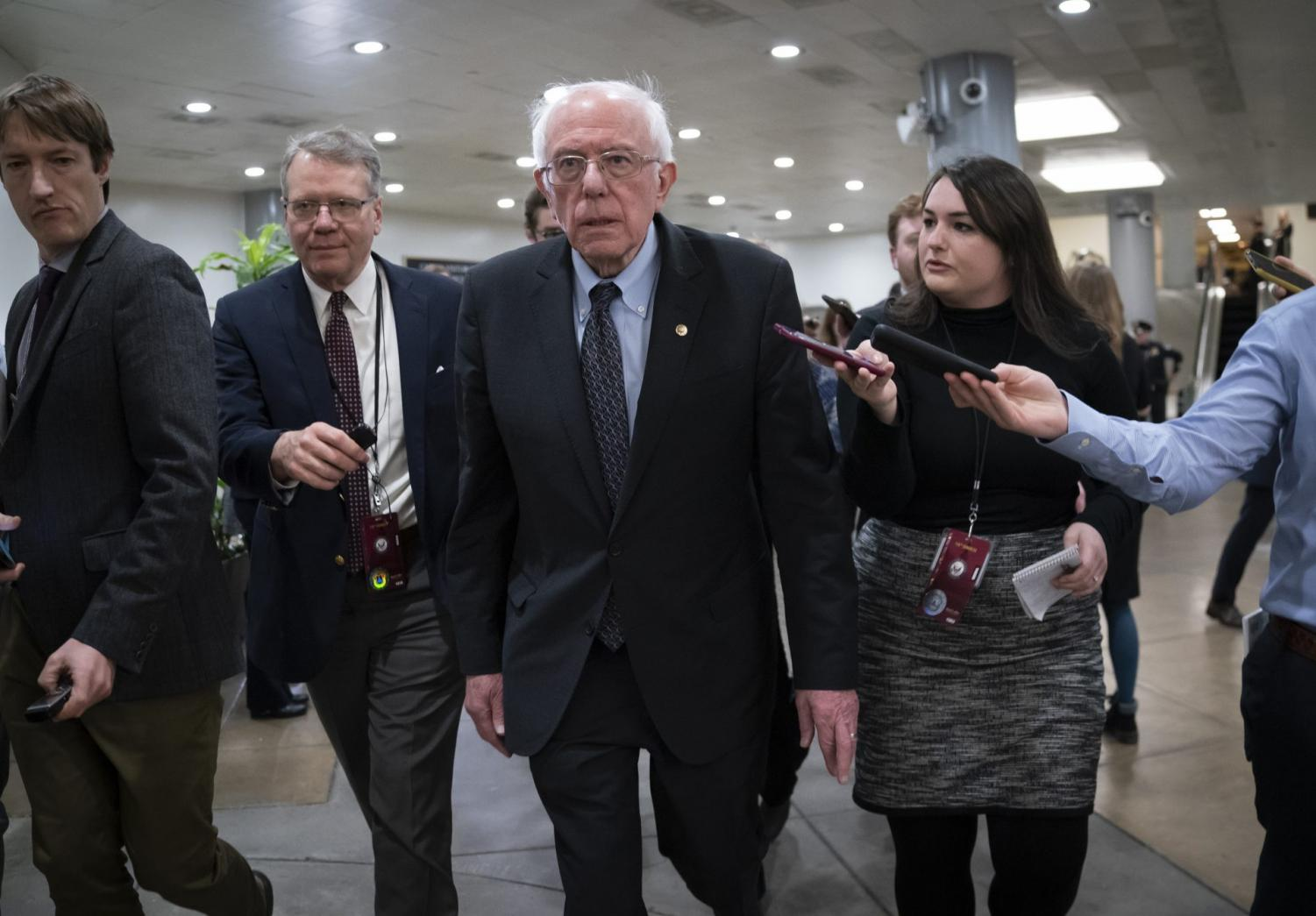 Democratic presidential candidate, Sen. Bernie Sanders, I-Vt., talks to reporters just after the start of the impeachment trial of President Donald Trump on charges of abuse of power and obstruction of Congress, at the Capitol in Washington, Thursday, Jan. 16, 2020.