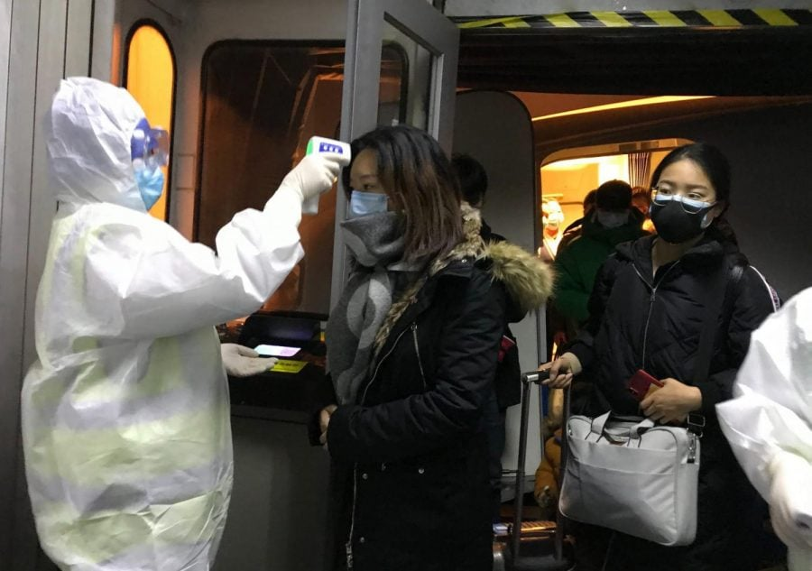 Chinese city stops outbound flights, trains to fight virus