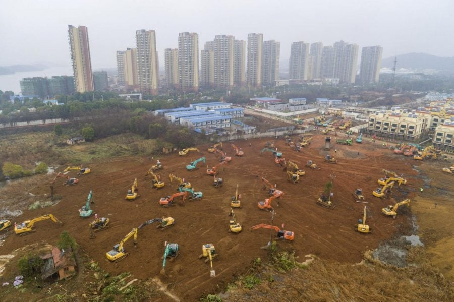 In this Friday, Jan. 24, 2020, file photo, heavy equipment works at a construction site for a field hospital in Wuhan in central China's Hubei Province. A patient in Southern California is third person in the U.S. to be diagnosed with the new pneumonia-like virus from China, health officials said.