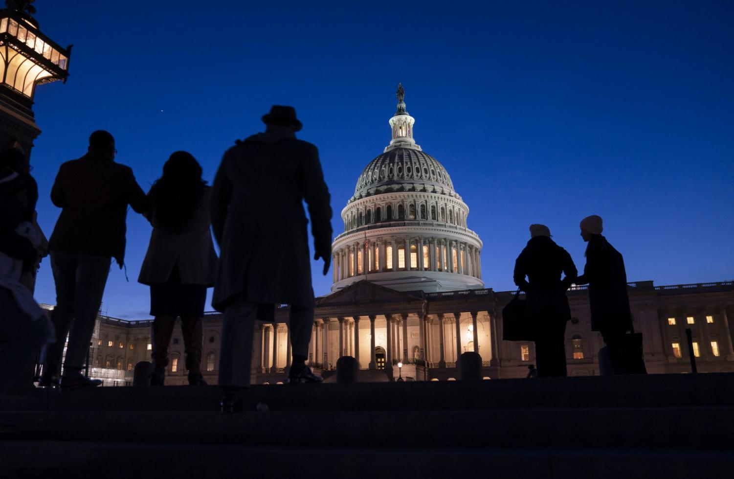 Night falls on the Capitol, in Washington during the impeachment trial of President Donald Trump. For all the gravity of a presidential impeachment trial, Americans don't seem to be giving it much weight. Web traffic and TV ratings tell a similar story, with public interest seeming to flag after the House voted last month to impeach a president for only the third time in U.S. history.