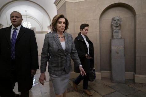 Speaker of the House Nancy Pelosi, D-Calif., arrives as defense arguments by the Republicans resume in the Senate impeachment trial of President Donald Trump on charges of abuse of power and obstruction of Congress, at the Capitol in Washington, Monday, Jan. 27, 2020.