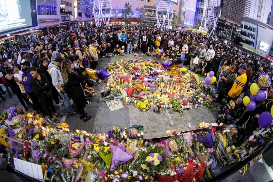 People gather at a memorial for Kobe Bryant near Staples Center Monday, Jan. 27, 2020, in Los Angeles. Bryant, the 18-time NBA All-Star who won five championships and became one of the greatest basketball players of his generation during a 20-year career with the Los Angeles Lakers, died in a helicopter crash Sunday.