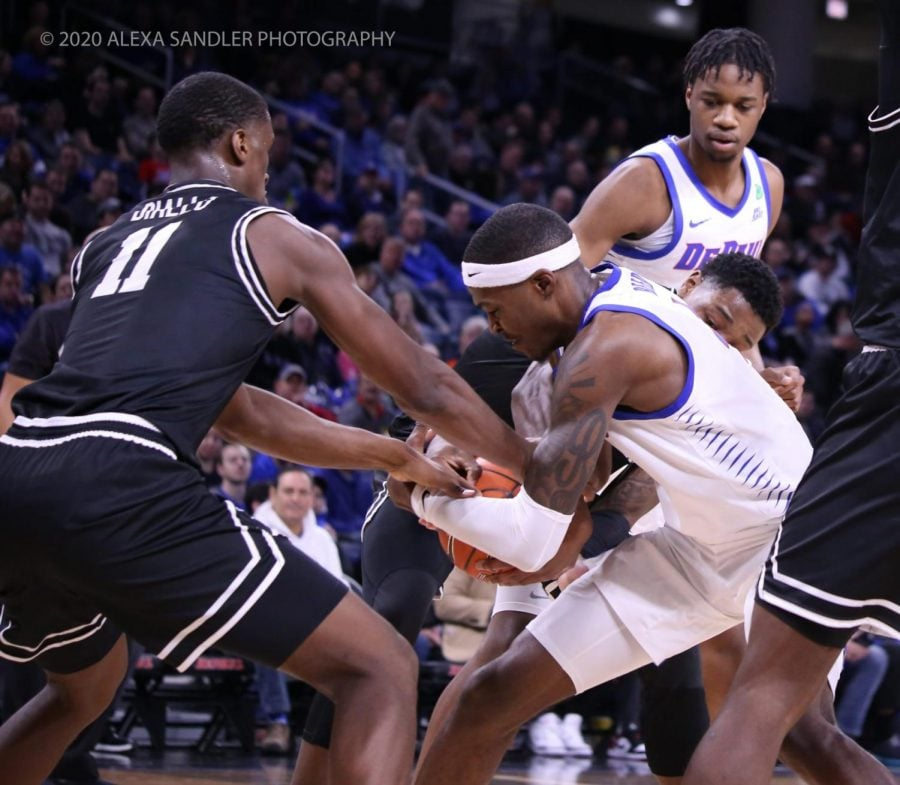 DePaul's Paul Reed and Providence's Alpha Diallo fight for the ball in the first half.
