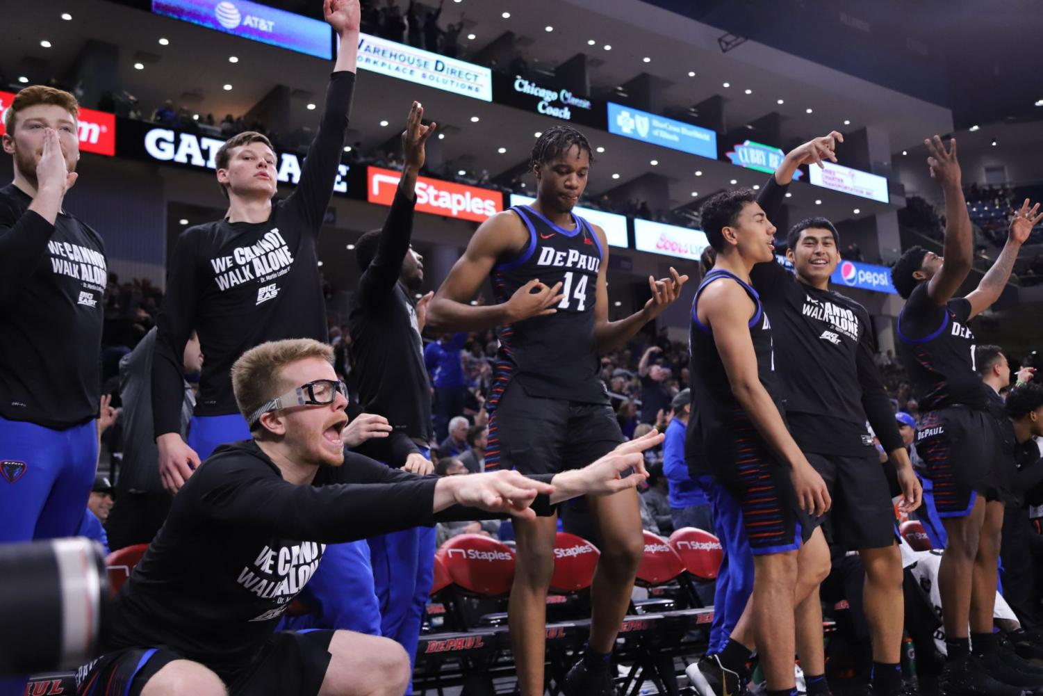 Pantelis Xidias (bottom left) and DePaul's bench celebrates a three-point shot as the Blue Demons continued to pile up points in the second half Saturday.