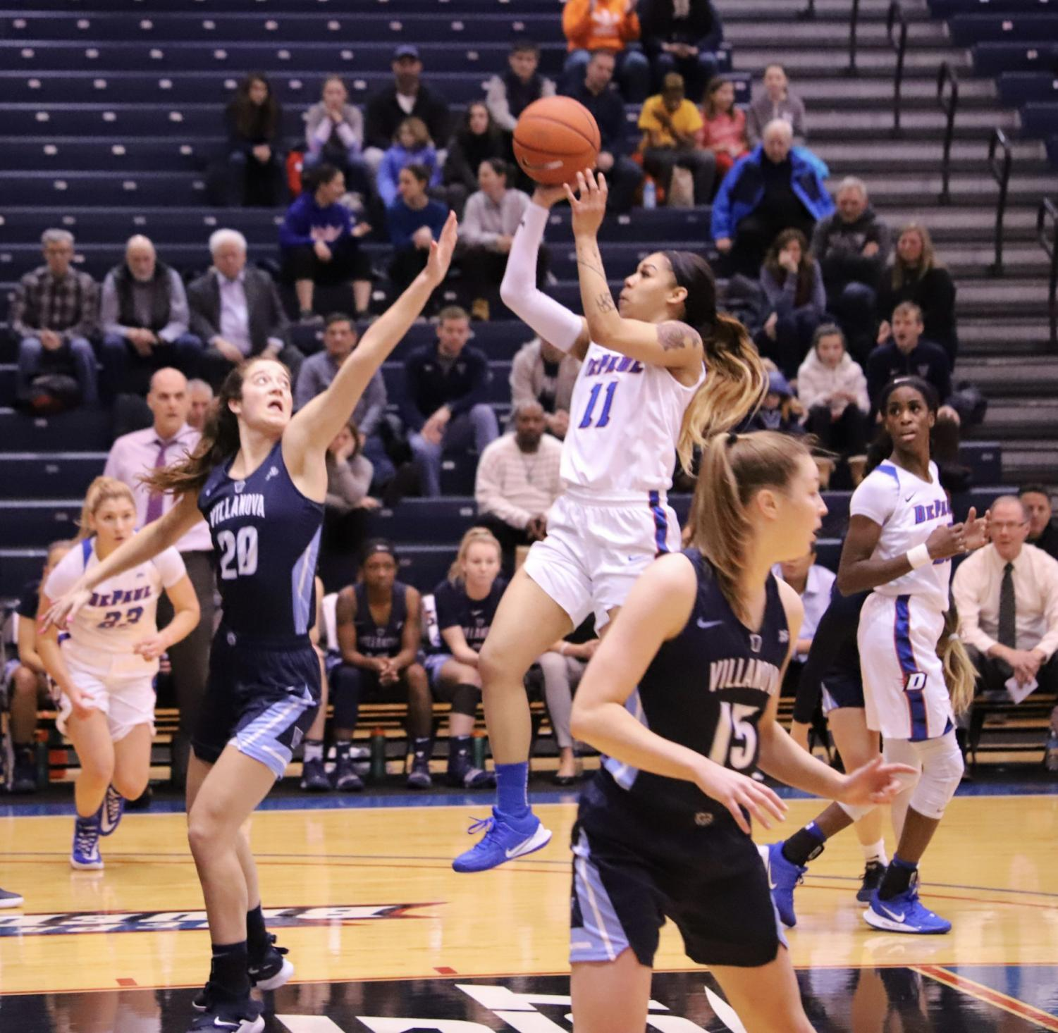 Sonya Morris goes up for a jumper in the lane in the first half against Villanova.