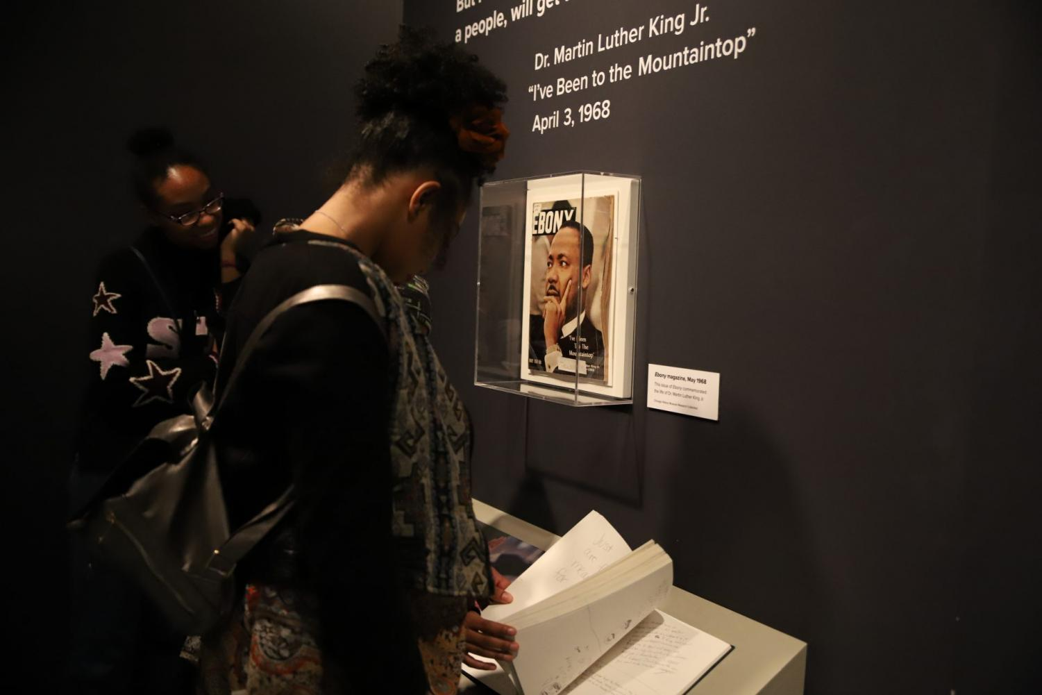A visitor looks over drafts of King's letters in the exhibition about his time in Chicago.