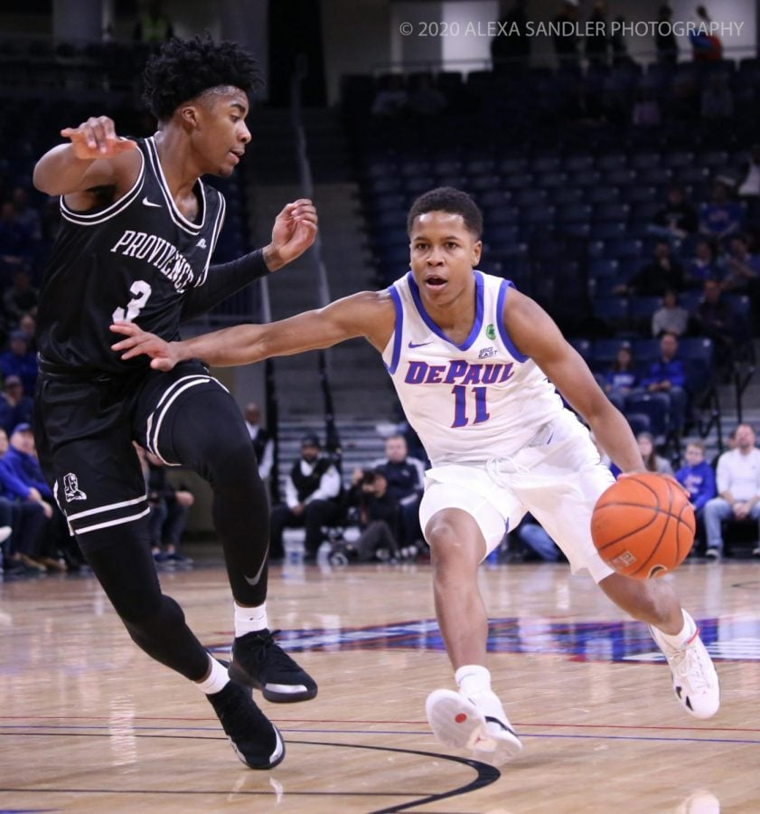 Charlie Moore drives in against a Providence defender during the game on Jan. 4. DePaul lost 66-65 to drop to 0-2 in conference play.