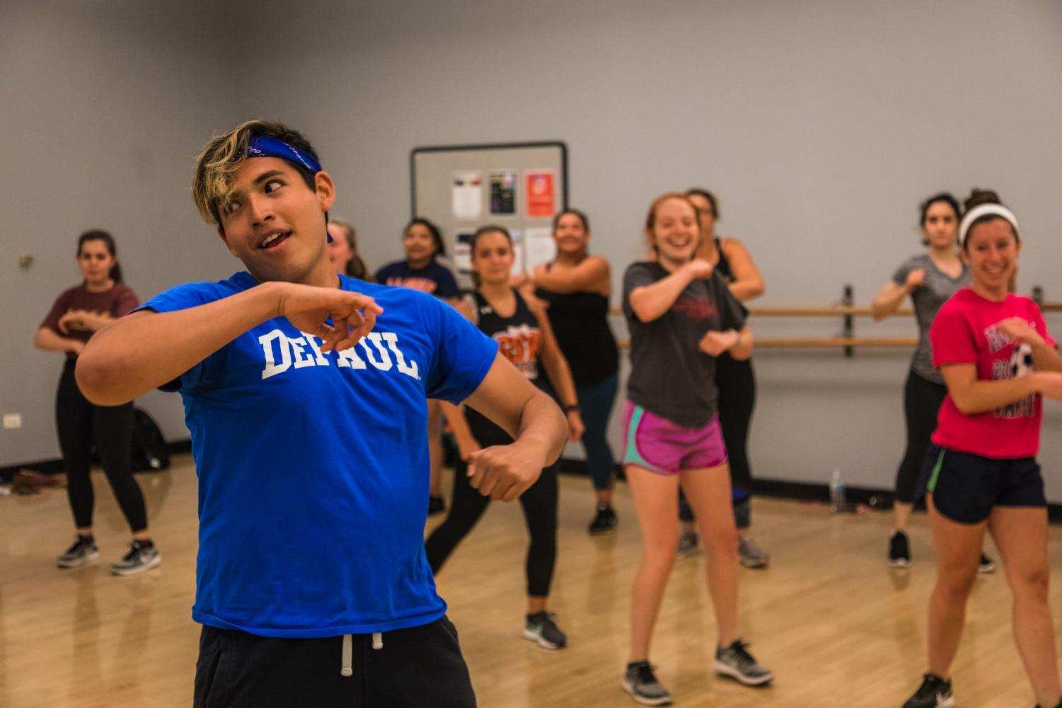 A fitness instructor leads a class in Zumba at the Ray Meyer Fitness Center.