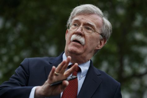 In this May 1, 2019 file photo, National security adviser John Bolton talks to reporters outside the White House in Washington.