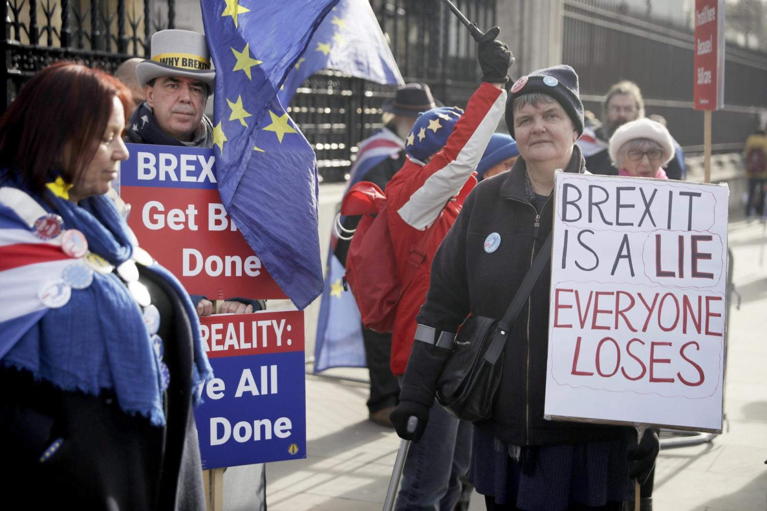 Anti-Brexit remain in the European Union supporter Steve Bray, second left, protests outside the Houses of Parliament to coincide with the weekly Prime Minister's Questions at the Houses of Parliament, in London, Wednesday, Feb. 5, 2020.