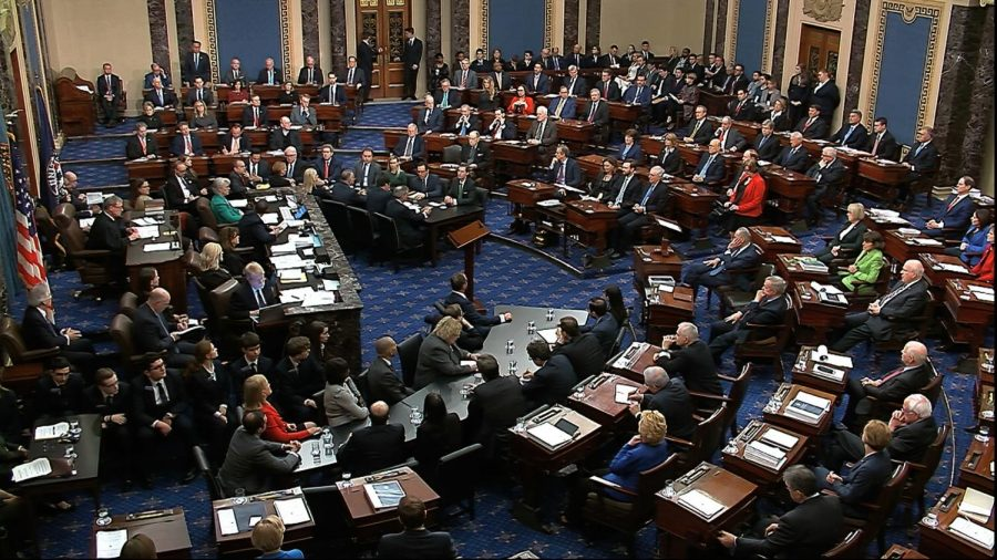 In this image from video, Sen. Mitt Romney, R-Utah, back row second from left, stands and cast a 'guilty' vote on the first article of impeachment, abuse of power, during the impeachment trial against President Donald Trump in the Senate at the U.S. Capitol in Washington, Wednesday, Feb. 5, 2020.