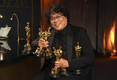 "Bong Joon-ho holds the Oscars for best original screenplay, best international feature film, best directing, and best picture for ""Parasite"" at the Governors Ball after the Oscars on Sunday, Feb. 9, 2020, at the Dolby Theatre in Los Angeles."