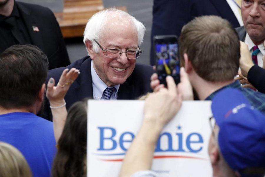 Democratic presidential candidate Sen. Bernie Sanders, I-Vt., greets supporters at a primary night election rally in Manchester, N.H., Tuesday, Feb. 11, 2020.
