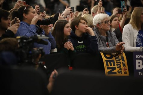 Supporters of Joe Biden listen as he speaks in Des Moines.