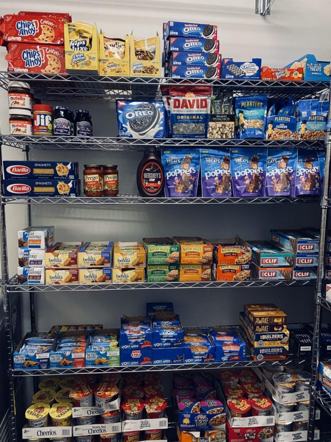The food pantry is stocked with non-perishables and frozen meals.