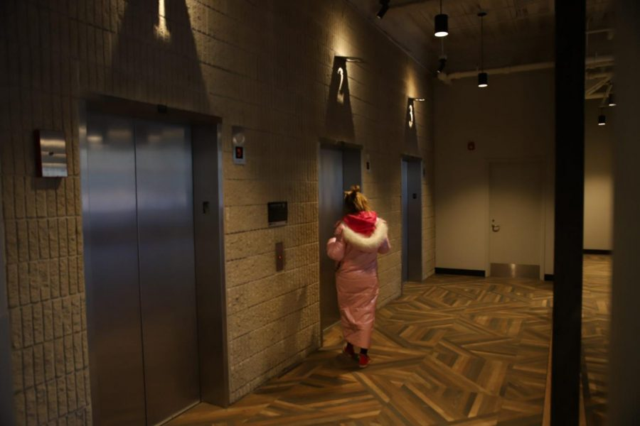 A resident waits for an elevator at Ion Lincoln Park.