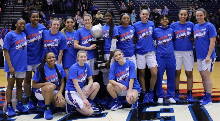 The DePaul Women's Basketball team poses with the Big East regular season trophy after a 97-63 win over Xavier on Sunday.
