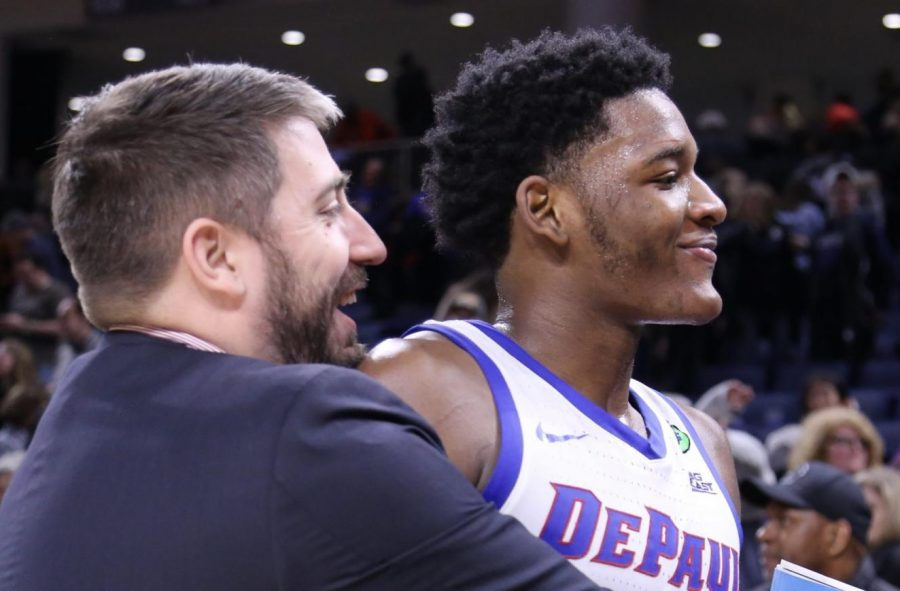 Asst. Director of Basketball Operations Matt Flemming embraces freshman forward Romeo Weems during his clutch, 18-point performance Saturday night.