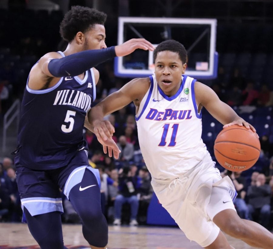 DePaul junior guard Charlie Moore attempts to drive to the basket in the first half against Villanova. Moore finished the game with eight points on 2-of-10 shooting.
