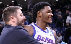 FILE-Asst. Director of Basketball Operations Matt Flemming embraces freshman forward Romeo Weems during his clutch, 18-point performance Saturday night.