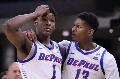 Romeo Weems and Darious Hall talk to each other during DePaul's 91-71 loss to Villanova on Feb. 19.