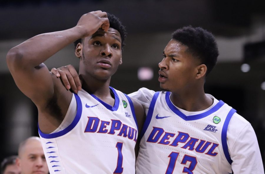 Romeo+Weems+and+Darious+Hall+talk+to+each+other+during+DePaul%27s+91-71+loss+to+Villanova+on+Feb.+19.