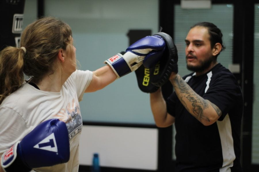 Cameron Chapman (left) trains with a fellow member of the boxing club on Wednesday, Feb. 12 at the Ray Meyer Fitness Center.