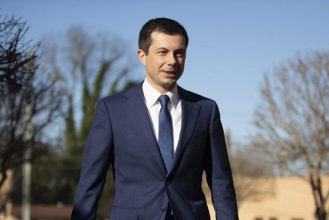 Democratic presidential candidate and former South Bend, Ind. Mayor Pete Buttigieg walks to speaks with members of the media, Sunday, March 1, 2020, in Plains, Ga.