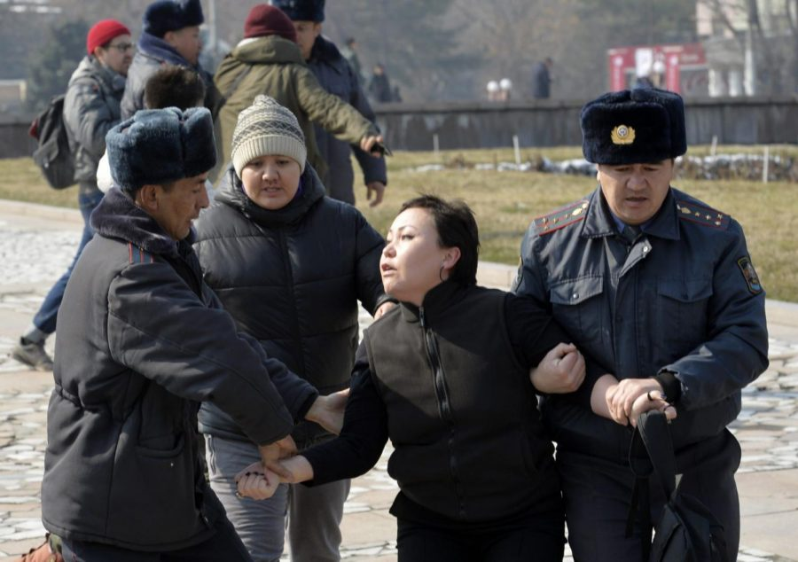 Kyrgyz+policemen+detain+an+activist+of+the+Femen+women%E2%80%99s+rights+movement+at+Victory+Square+during+celebration+of+the+International+Women%E2%80%99s+Day+in+Bishkek%2C+Kyrgyzstan%2C+Sunday%2C+March+8%2C+2020.